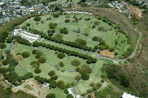 Aerial view of Punchbowl Cemetery or the National Memorial Cemetery of the Pacific, with parts under construction, which is visited by millions of tourist and island locals every year on the tropical island of Oahu in Honolulu, Hawaii, USA. April 2016