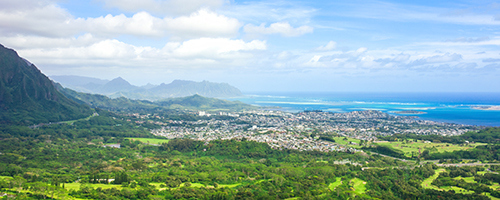 Beautiful view of Kaneohe as seen from high above on Pali Lookout towards the ocean and the city of Kaneohe